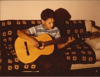 Filippo playing classical guitar