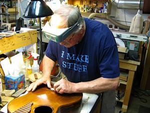 Randy Reynolds fitting a saddle on a Reynolds Concert Grand - a Kasha braced Western Red Cedar double top classical guitar.
