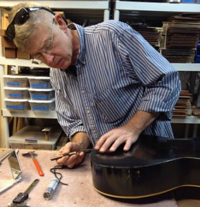 Todd Stock preparing for acoustic surgery at his repair bench.