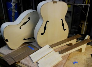 Prior to neck carves, bodies in white, the Octave Mandolins take shape.