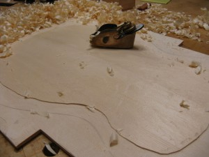 Carving the top with a convex hand plane.