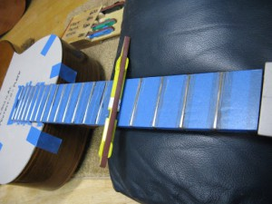 Fret level on a smallman braced spanish classical guitar.