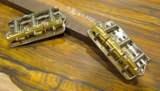 Custom steel bobtail bridge with compensated polished brass saddles